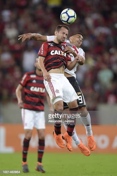 Everton Ribeiro of Flamengo struggles for the ball with Diego Souza of Sao Paulo during the match between Flamengo and Sao Paulo as part of...