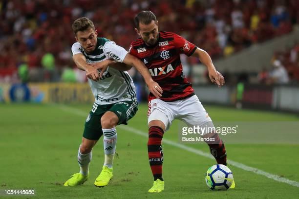 Everton Ribeiro of Flamengo struggles for the ball with Hyoran of Palmeiras during a match between Flamengo and Palmeiras as part of Brasileirao...