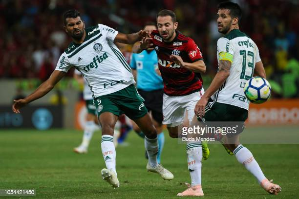Everton Ribeiro of Flamengo struggles for the ball with Thiago Santos and Luan Garcia of Palmeiras during a match between Flamengo and Palmeiras as...