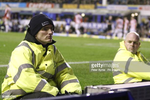 Everton stewards keep watch over the fans during the game
