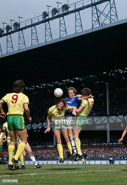 Everton striker Andy Gray causes problems for Norwich City defenders Steve Bruce and Dave Watson during their First Division match at Goodison Park...