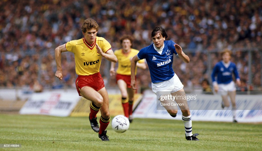 Everton striker Graeme Sharp (r) and Watford defender Neil Price chase a loose ball during the 1984 FA Cup Final at Wembley Stadium on May 19, 1984 in London, England.