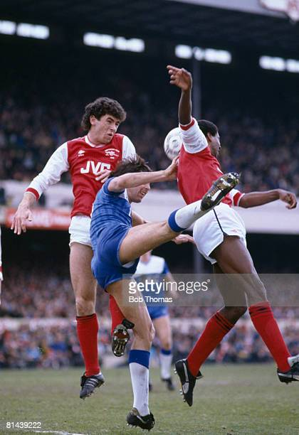 Everton striker Graeme Sharp is outnumbered by Arsenal defenders Martin Keown and Viv Anderson during their 1st Division match at Highbury April 12th...