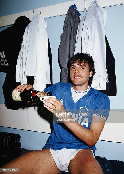 Everton striker Graeme Sharp pours himself a mug of champagne in the dressing room after the Canon League Division One match against West Ham United...