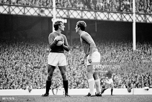 Everton striker Joe Royle confronts Manchester United goalkeeper Alex Stepney during a First Division match at Goodison Park in Liverpool circa 1968