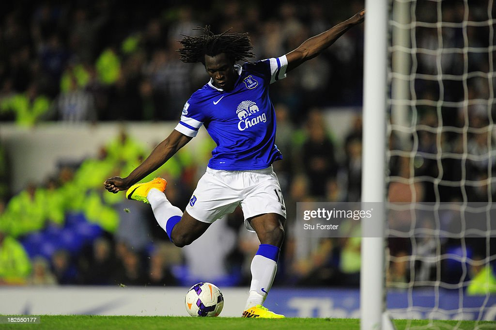 Everton striker Romelu Lukaku lashes the ball into an empty net to score the third goal during the Barclays Premier League match between Everton and Newcastle United at Goodison Park on September 30, 2013 in Liverpool, England.