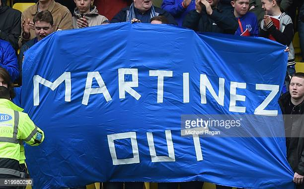 Everton supporters hold a banner against Roberto Martinez Manager of Everton prior to the Barclays Premier League match between Watford and Everton...
