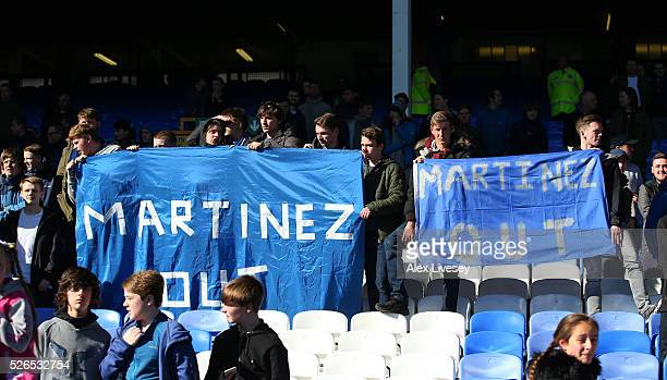 Everton supporters hold banners 'Martinez Out'' after the Barclays Premier League match between Everton and AFC Bournemouth at Goodison Park on April...
