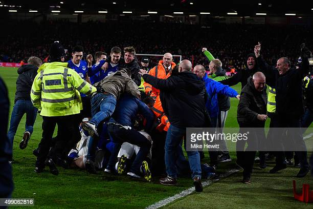 Everton supporters invade into the pitch to celeberate their team's third goal during the Barclays Premier League match between AFC Bournemouth and...