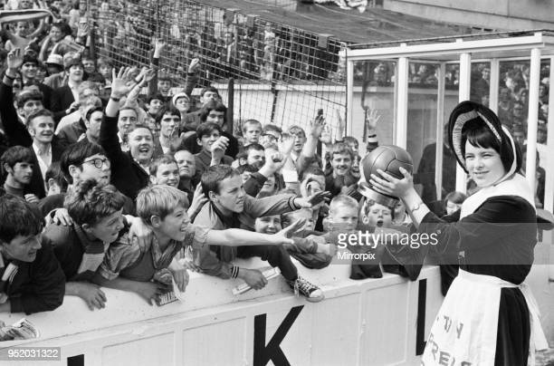Everton toffee lady 16 year old Catherine Dunn holds a trophy presented to Everton supporters before the match against Crystal Palace 16th August 1969
