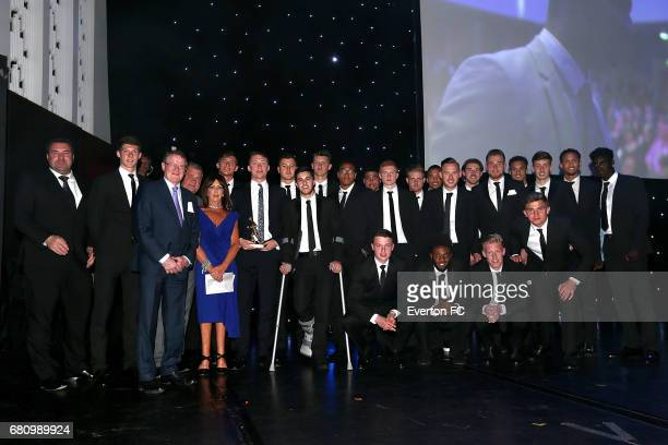 Everton U23 squad receives the Howard Kendall award from Ian Snodin and Lily Kendall during the Everton End Of Season Awards at The Liverpool...