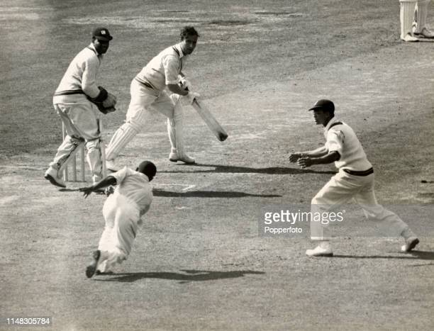 Everton Weekes fails to catch Denis Compton in the slips off Alfred Valentine during the 4th Test match between England and the West Indies at the...