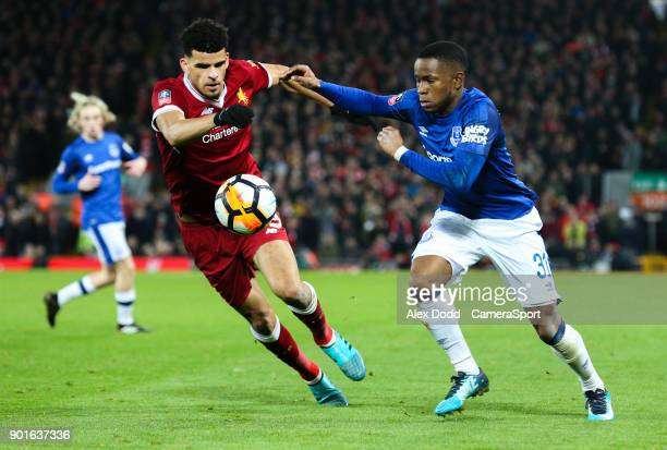 Everton's Ademola Lookman battles with Liverpool's Dominic Solanke during the Emirates FA Cup Third Round match between Liverpool and Everton at...