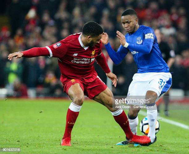 Everton's Ademola Lookman battles with Liverpool's Joe Gomez during the Emirates FA Cup Third Round match between Liverpool and Everton at Anfield on...