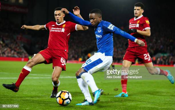 Everton's Ademola Lookman crosses under pressure from Liverpool's Trent AlexanderArnold during the Emirates FA Cup Third Round match between...