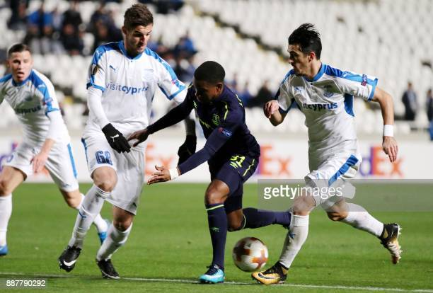 Everton's Ademola Lookman fights for the ball against Apollon Limassol's Andrei Pitian during the UEFA Europa League group stage football match...