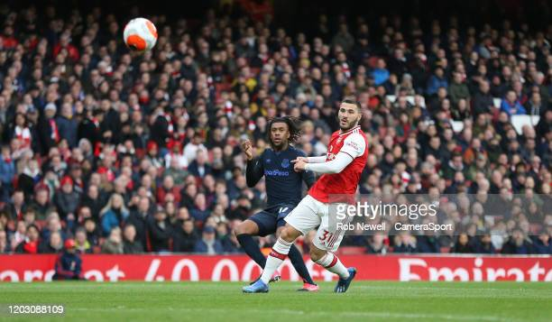 Everton's Alex Iwobi with a shot under pressure from Arsenal's Sead Kolasinac during the Premier League match between Arsenal FC and Everton FC at...