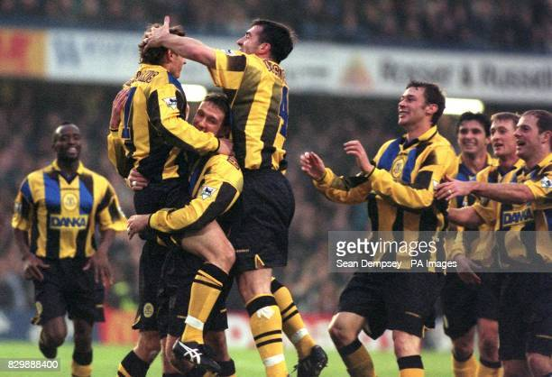 Everton's Andrei Kanchelskis jumps into the arms of team mate Andy Hinchcliffe as he celebrates his goal against Chelsea at Stamford Bridge this...