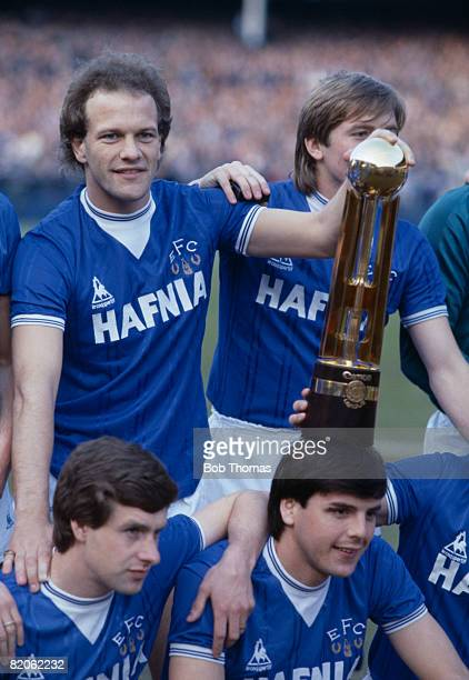 Everton's Andy Gray Gary Stevens Kevin Sheedy and Graeme Sharp with the Canon First Division Championship trophy after the presentation prior to...