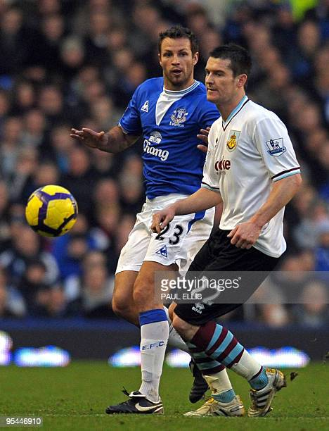 Everton's Australian defender Lucas Neill vies with Burnley's English forward David Nugent during the English Premier League football match between...