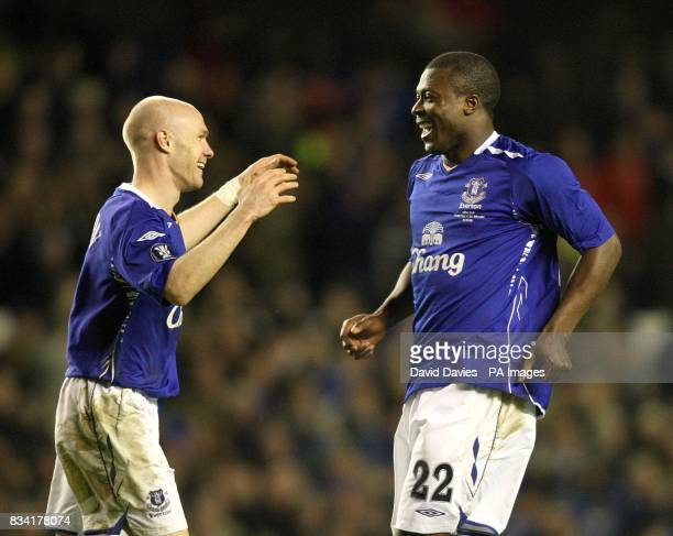 Everton's Ayegbeni Yakubu celebrates scoring the third goal of the match with team mate Andrew Johnson