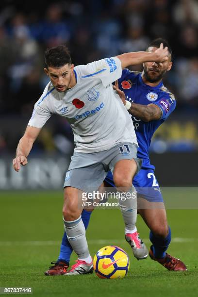 Everton's Belgian striker Kevin Mirallas vies with Leicester City's Algerian midfielder Riyad Mahrez during the English Premier League football match...