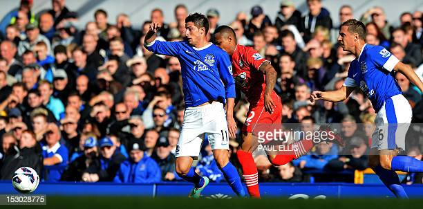 Everton's Belgian striker Kevin Mirallas vies with Southampton's English defender Nathaniel Cline during the English Premier League football match...