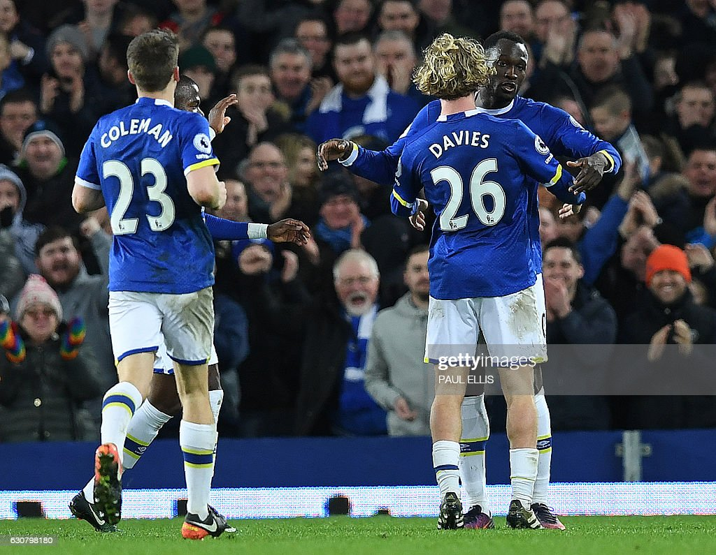 Everton's Belgian striker Romelu Lukaku (R) celebrates scoring his team's third goal during the English Premier League football match between Everton and Southampton at Goodison Park in Liverpool, north west England on January 2, 2017. / AFP / Paul ELLIS / RESTRICTED TO EDITORIAL USE. No use with unauthorized audio, video, data, fixture lists, club/league logos or 'live' services. Online in-match use limited to 75 images, no video emulation. No use in betting, games or single club/league/player publications. /