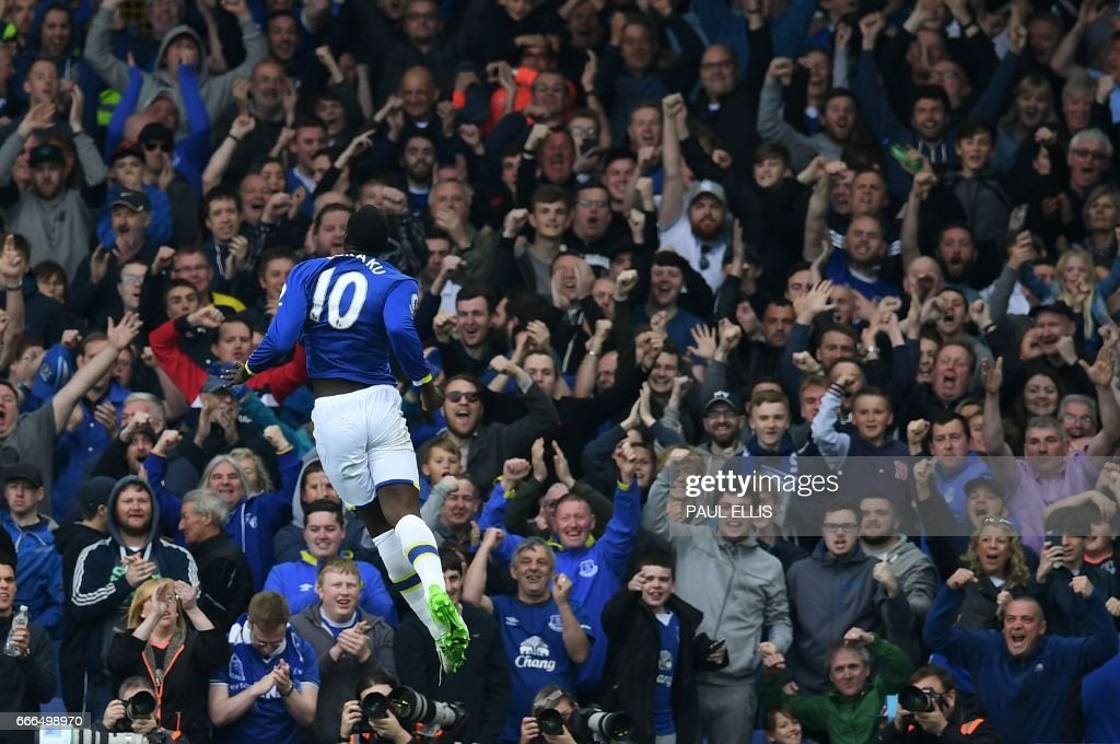 Everton's Belgian striker Romelu Lukaku celebrates scoring his team's fourth goal during the English Premier League football match between Everton and Leicester City at Goodison Park in Liverpool, north west England on April 9, 2017. / AFP PHOTO / Paul ELLIS / RESTRICTED TO EDITORIAL USE. No use with unauthorized audio, video, data, fixture lists, club/league logos or 'live' services. Online in-match use limited to 75 images, no video emulation. No use in betting, games or single club/league/player publications. /