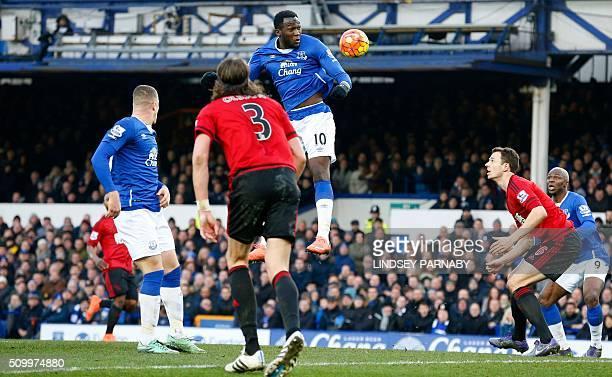 Everton's Belgian striker Romelu Lukaku heads the ball towards goal but fails to score during the English Premier League football match between...