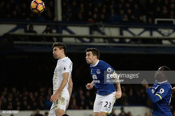 Everton's Belgian striker Romelu Lukaku watches as Everton's Irish defender Seamus Coleman heads the ball to score his team's first goal during the...