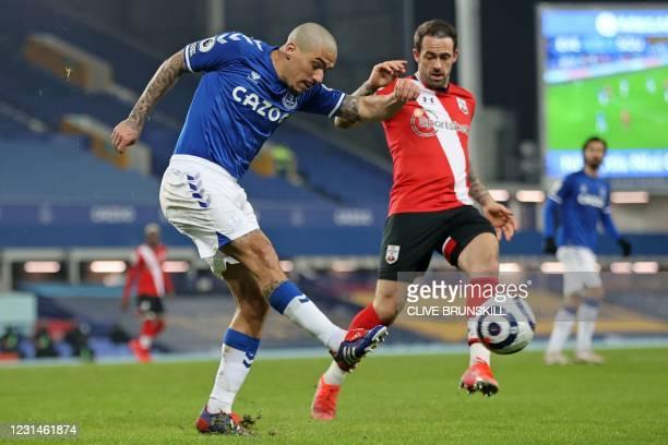 Everton's Brazilian midfielder Allan vies with Southampton's English striker Danny Ings during the English Premier League football match between...