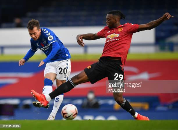 Everton's Brazilian striker Bernard scores the opening goal past Manchester United's English defender Aaron Wan-Bissaka during the English Premier...
