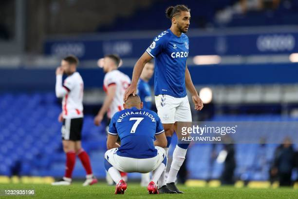 Everton's Brazilian striker Richarlison and Everton's English striker Dominic Calvert-Lewin look on after the final whistle of the English Premier...