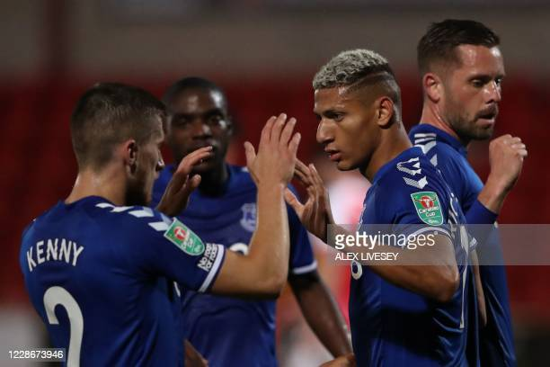Everton's Brazilian striker Richarlison celebrates after he scores his team's first goal during the English League Cup third round football match...