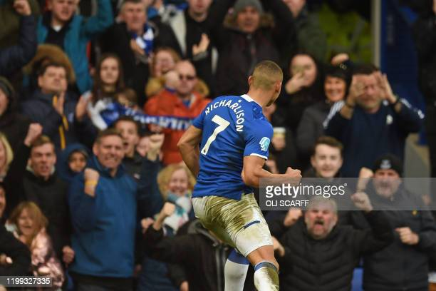 Everton's Brazilian striker Richarlison celebrates in front of supporters after scoring their second goal during the English Premier League football...