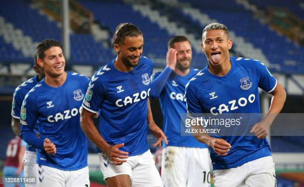 Everton's Brazilian striker Richarlison celebrates scoring his team's second goal with his teammates during the English League Cup fourth round...