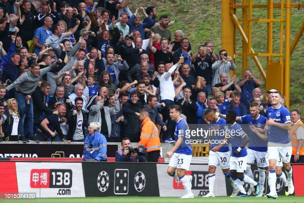 Everton's Brazilian striker Richarlison celebrates scoring the opening goal during the English Premier League football match between Wolverhampton...