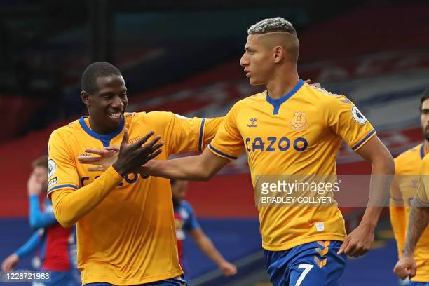 Everton's Brazilian striker Richarlison celebrates with Everton's French midfielder Abdoulaye Doucoure after scoring their second goal from the...