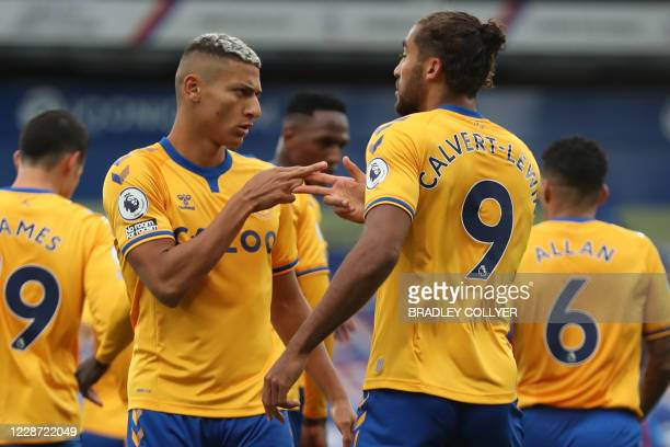Everton's Brazilian striker Richarlison celebrates with Everton's English striker Dominic CalvertLewin after scoring their second goal from the...