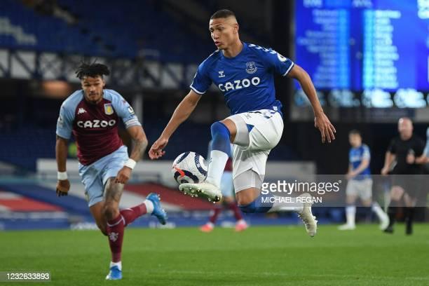 Everton's Brazilian striker Richarlison controls the ball during the English Premier League football match between Everton and Aston Villa at...