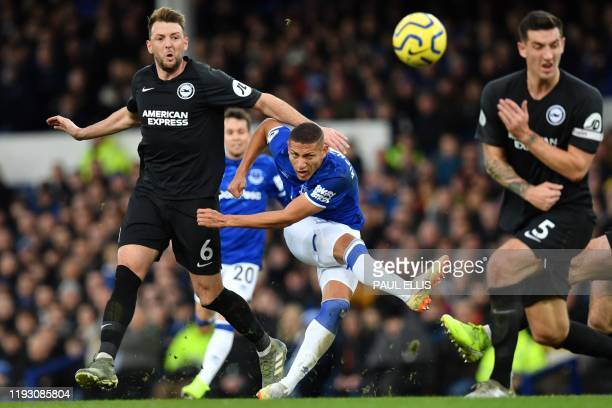 Everton's Brazilian striker Richarlison has an unsuccessful shot during the English Premier League football match between Everton and Brighton Hove...
