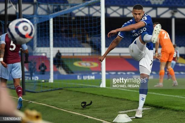 Everton's Brazilian striker Richarlison kicks a ball in frustration during the English Premier League football match between Everton and Aston Villa...