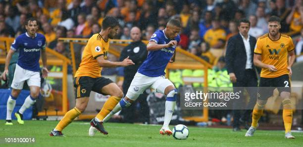Everton's Brazilian striker Richarlison runs with the ball during the English Premier League football match between Wolverhampton Wanderers and...