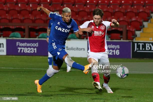 Everton's Brazilian striker Richarlison scores his team's second goal during the English League Cup third round football match between Fleetwood Town...