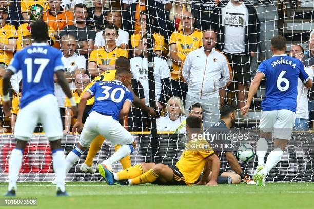 Everton's Brazilian striker Richarlison scores the opening goal during the English Premier League football match between Wolverhampton Wanderers and...
