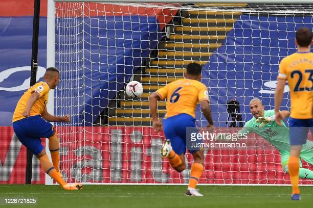 Everton's Brazilian striker Richarlison scores their second goal from the penalty spot during the English Premier League football match between...