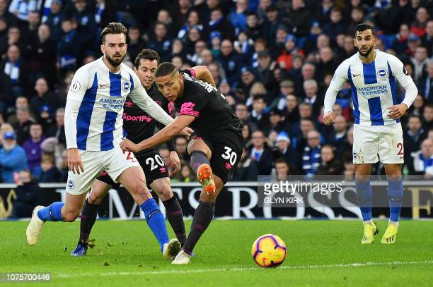 Everton's Brazilian striker Richarlison shoots but fails to score during the English Premier League football match between Brighton and Hove Albion...