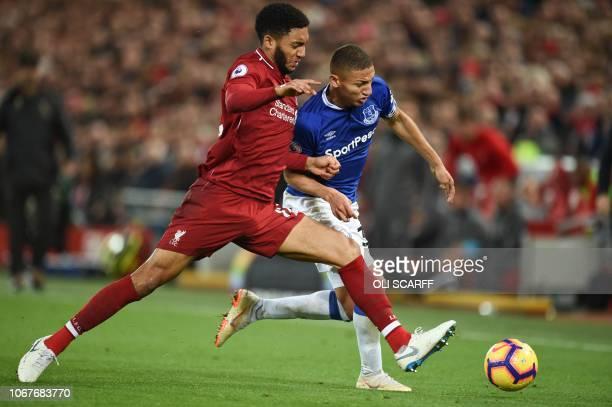 Everton's Brazilian striker Richarlison vies with Everton's Portuguese midfielder André Gomes during the English Premier League football match...