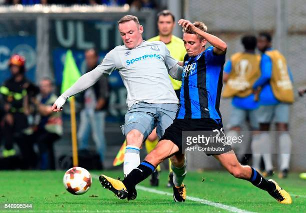 Everton's British forward Wayne Rooney vies with Atalanta's Belgian defender Timothy Castagne during the UEFA Europa League Group E football match...